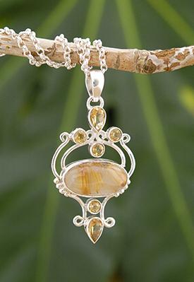 Zilveren hanger met rutielkwarts en citrien