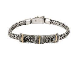 Zilveren tulang naga armband met gouden accenten uit Bali